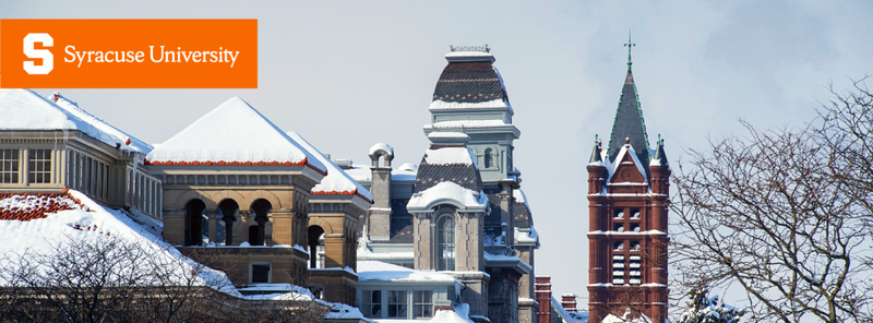 Cover photo of campus rooftops on a snowy day